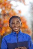 Bambino maschio dell'afroamericano che gioca all'aperto Fotografia Stock Libera da Diritti
