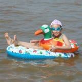 Bambino nel mare Fotografia Stock