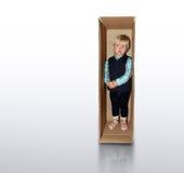 Bambino nella casella Fotografie Stock
