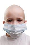Bambino nella mascherina della medicina Fotografia Stock