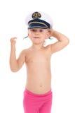 Bambino nella protezione del capitano immagini stock