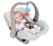 Bambino nella sede di automobile del bambino fotografia stock