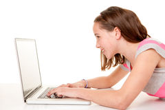 Bambino facendo uso del computer portatile del Internet Immagine Stock Libera da Diritti