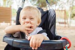 Bambino in passeggiatore Fotografie Stock Libere da Diritti