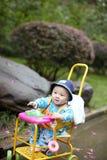 Bambino in passeggiatore di seduta Immagine Stock