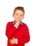 Bambino pensieroso con il jersey rosso Fotografia Stock