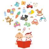 Bambino per si veda un libro illustrato Fotografia Stock