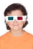 Bambino piacevole con i vetri 3D Fotografia Stock
