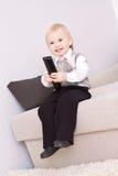 Bambino piacevole con telecomando Fotografie Stock