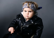 Bambino in rivestimento di cuoio Immagine Stock