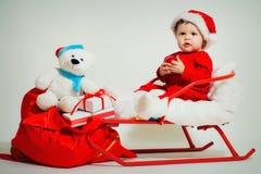 Bambino Santa con i regali di natale Fotografia Stock Libera da Diritti