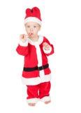 Bambino Santa con il bastoncino di zucchero Fotografia Stock Libera da Diritti
