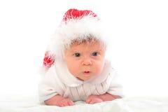 Bambino serio in cappello rosso di natale Immagini Stock