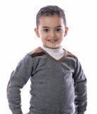 Bambino sicuro che sta con un sorriso Fotografie Stock