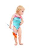 Bambino sorpreso in costume da bagno con il pinwheel Fotografia Stock