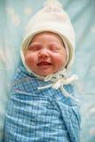 Bambino sorridente appena nato Fotografie Stock