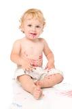 Bambino sorridente che gioca con i colori Fotografia Stock