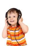 Bambino sorridente con le cuffie Fotografie Stock Libere da Diritti