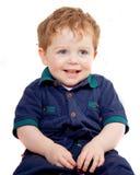 Bambino sorridente su una priorità bassa bianca fotografia stock