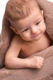 Bambino sotto il tovagliolo Immagini Stock