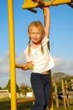Bambino sul campo da giuoco Fotografia Stock