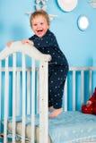 Bambino sul letto Immagine Stock Libera da Diritti