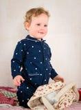 Bambino sul letto Fotografia Stock