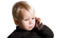Bambino sul telefono Fotografie Stock Libere da Diritti