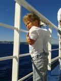 Bambino sul traghetto Fotografia Stock