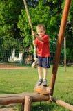 Bambino sull'oscillazione della corda Immagine Stock Libera da Diritti