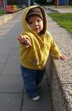 Bambino sulla condizione del campo da giuoco Fotografia Stock