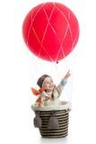 Bambino sulla mongolfiera con indicare mano su Fotografia Stock Libera da Diritti