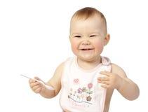 Bambino sveglio con il cucchiaio fotografia stock libera da diritti