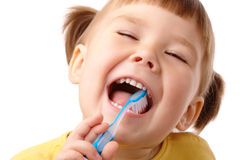 Bambino sveglio con il toothbrush fotografia stock libera da diritti