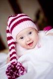 Bambino sveglio in un cappello con il pompom Immagine Stock Libera da Diritti