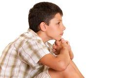 Bambino thoutful di seduta Fotografie Stock Libere da Diritti
