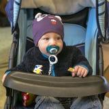 Bambino in trasporto Immagine Stock