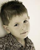Bambino triste, annoiato, daydreaming immagine stock
