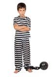 Bambino triste con la sfera del prigioniero Fotografie Stock Libere da Diritti