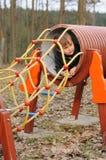 Bambino in tubo Fotografia Stock