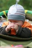 Bambino in un carrello Fotografia Stock