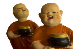 Bambola buddista del principiante isolata su fondo bianco fotografie stock
