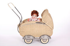 Bambola-carrozzina antiquata Fotografia Stock