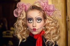 Bambola con gli archi Immagini Stock