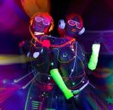 Bambola cyber femminile della discoteca sexy al neon uv di incandescenza Fotografie Stock Libere da Diritti