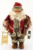 Bambola del Babbo Natale con la slitta Fotografia Stock