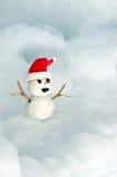 Bambola del pupazzo di neve che indossa Red Hat Fotografia Stock Libera da Diritti