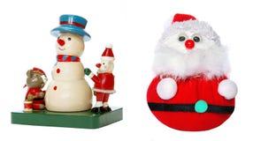 Bambola dell'uomo della neve e di Santa Claus Fotografie Stock Libere da Diritti