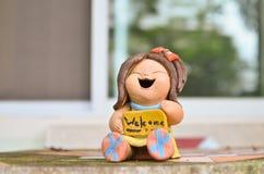 Bambola della pietra del segno positivo sulla tavola Fotografia Stock