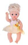 Bambola della ragazza che si siede in vestito variopinto Fotografie Stock Libere da Diritti